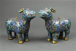 Pair of Chinese cloisonne enamel mythical beasts