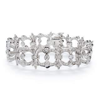 A diamond and eighteen karat white gold bracelet
