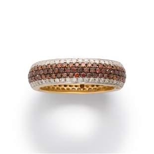 A colored diamond, diamond and fourteen karat gold ring