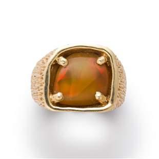 An opal and fourteen karat gold ring
