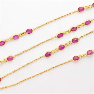 A ruby and eighteen karat gold necklace