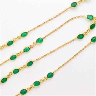 An emerald and eighteen karat gold necklace