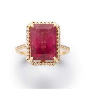 A pink tourmaline, diamond and fourteen karat gold ring