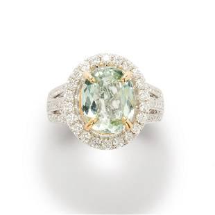 A greenish blue tourmaline, diamond and fourteen karat