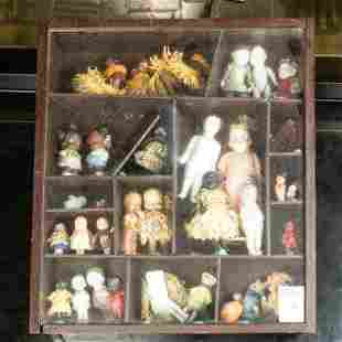 (lot of 34) Miniature dolls mounted in a case