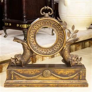 Hollywood Regency style gilt mantle clock, the bezel