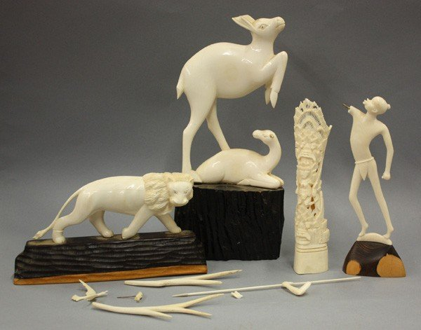 263: carved ivory lion, deer, warrior, totem pole