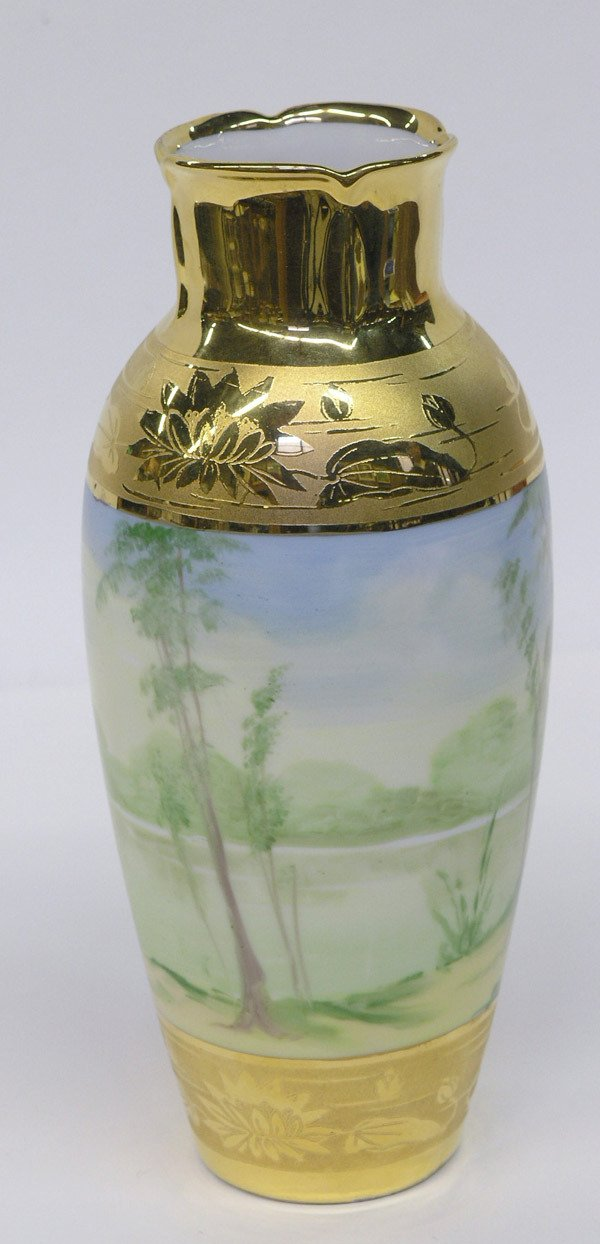 21: Limoges decorated and gilt vase
