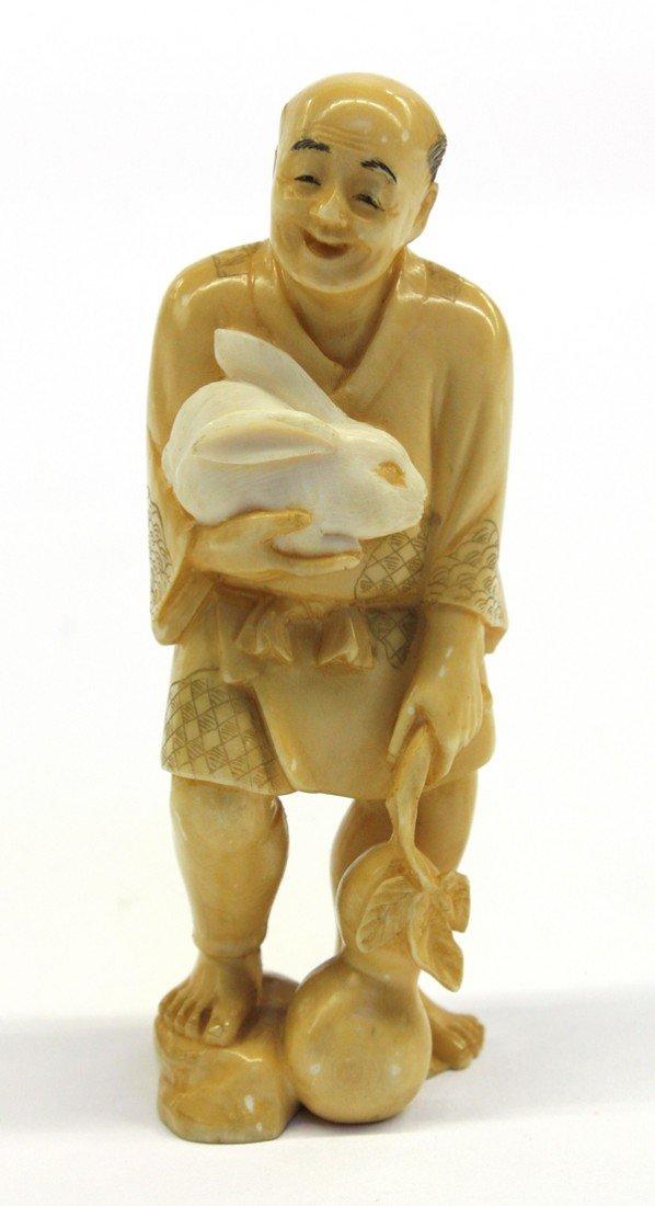 12: Japanese tinted ivory figural okimono, Showa
