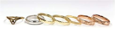 686 Collection of seven gold band rings