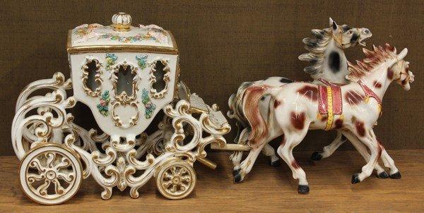 6016: Ceramic polychrome and gilt horse drawn carriage