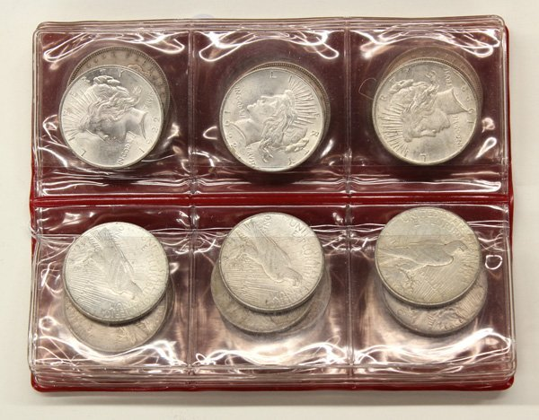4722: Lot of US silver dollars dating from 1877-1926