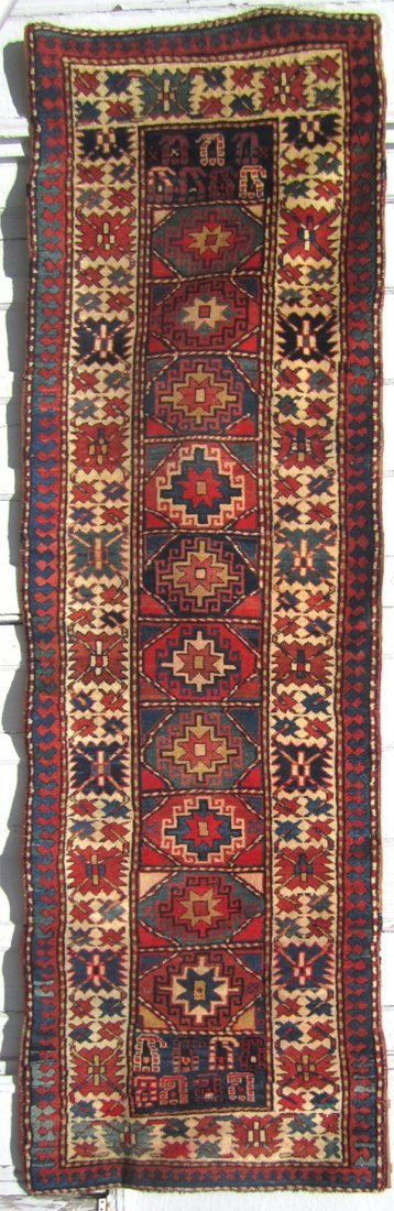 13: Kazak long rug