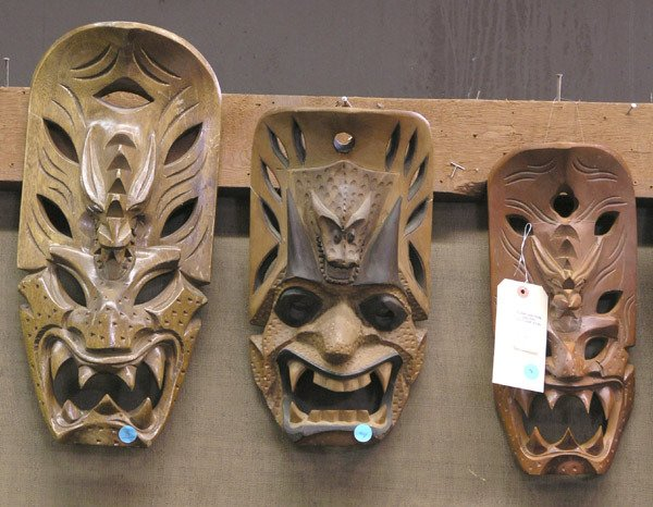 3: Carved wood face masks, South Pacific