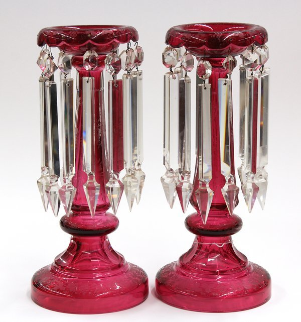 2000: Two cranberry glass candlestick holders
