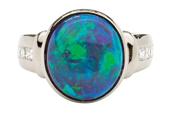 2367: White gold cabochon black opal diamond ring