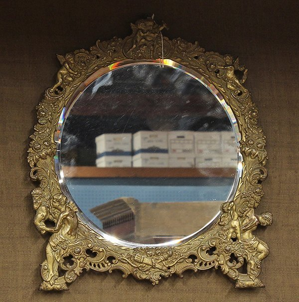 2019: Renaissance style gilt mounted looking glass
