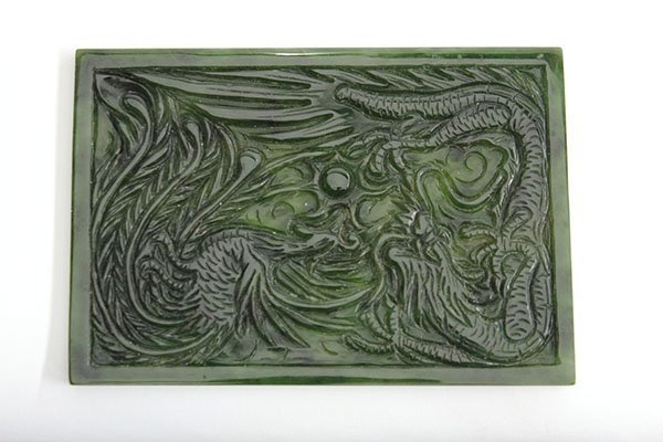 4002: Chinese spinach jade plaque, carved with a styliz