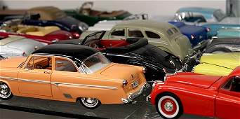 Associated group of die-cast metal model cars and truck