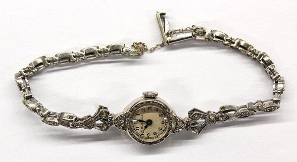 A lady's white gold and diamond wristwatch, Bulova