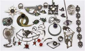 Collection of mostly silver jewelry items
