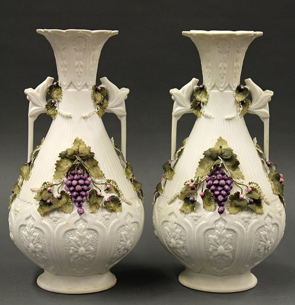 Pair of  Continental bisque polychrome decorated vases