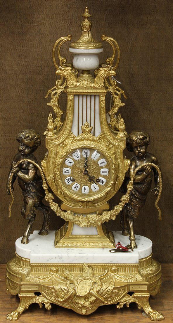 Continental patinated and gilt bronze mantle clock