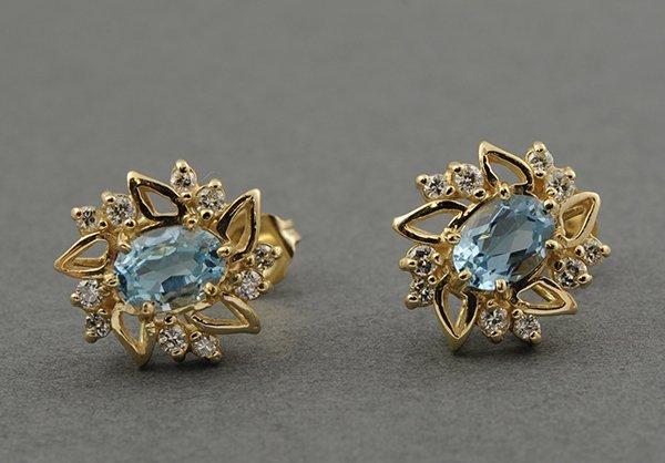 Pair of blue topaz diamond yellow gold earrings