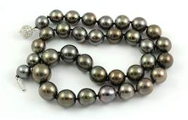 Black South Sea cultured pearl and 14k white gold