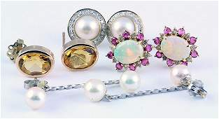 Collection of gold earrings opal ruby diamond pearl