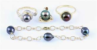 Collection of black cultured pearl and 14k yellow gold