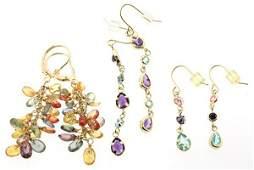 Three pairs of multi-colored gemstone earrings yellow