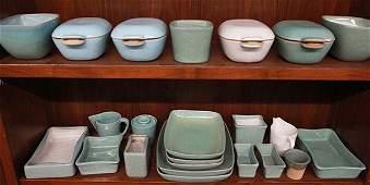 Two shelves of mid-century Glidden art pottery