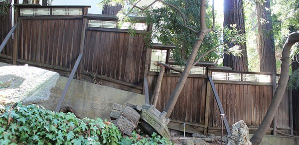 Japanese-style wood fencing (left side of house)