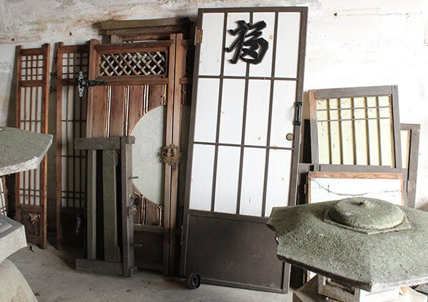 Assorted group of Japanese windows, wooden doors and