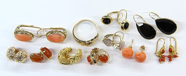 Collection of gem and gold jewelry items