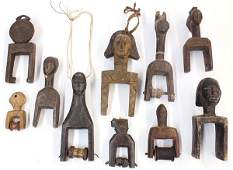 lot of 10  West African figural weaving pulleys