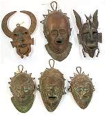West African decorative bronze masks in the Bobo and