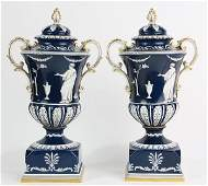 Pair of covered porcelain urns in the Neoclassical