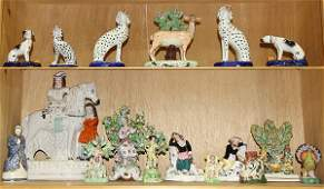 Two shelves of Staffordshire figural groups including