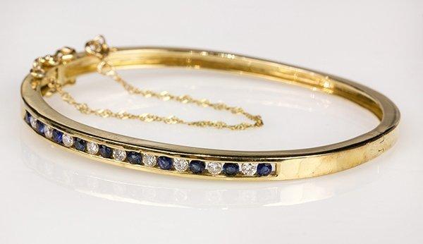 Sapphire, diamond and 14k yellow gold bangle bracelet