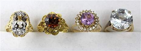 (Lot of 4) Multi-stone, yellow gold and sterling rings