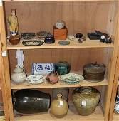 Three shelves of Asian Items