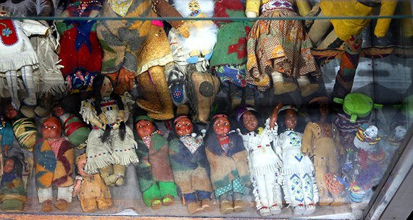 (lot of ) One shelf of Native American style dolls,