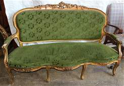 Louis XV style gilt carved settee with rocaille accents