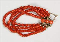 Coral bead and 12K yellow gold multi-strand bracelet