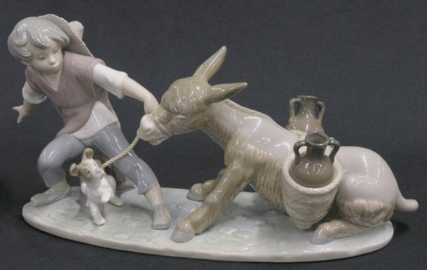 22: Lladro figural group, boy and donkey