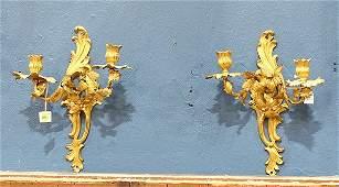 Pair of Louis XV style ormolu sconces