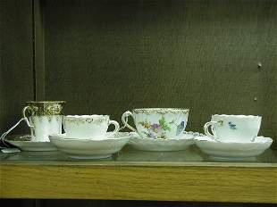 Four porcelain cups and saucers