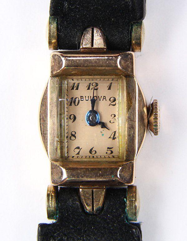 Lady's Retro Bulova 14k rose gold and metal wristwatch